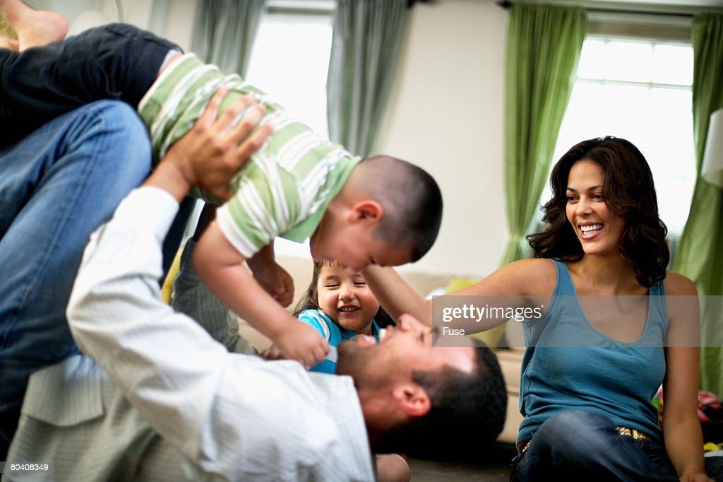 Family Wrestling Playfully : Stock Photo