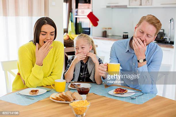 family yawning during breakfast - yawning mother child stock photos and pictures