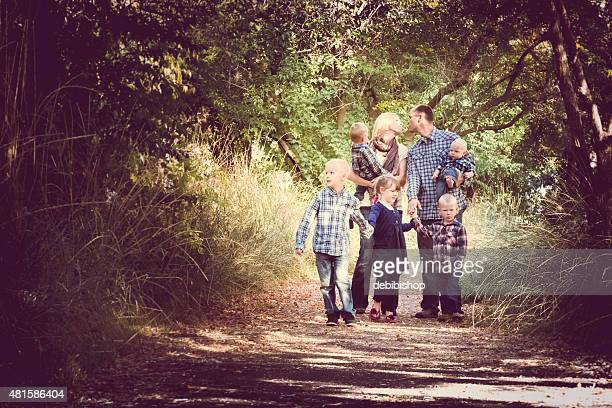 Family - Young Adult Couple & Five Children Outdoors  Nature