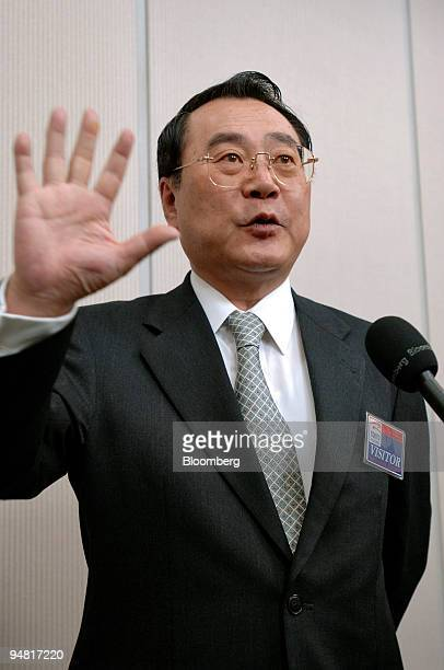 FamilyMart Co President Junji Ueda gestures as he speaks to a reporter after a press briefing at the Tokyo Stock Exchange Tuesday April 12 2005