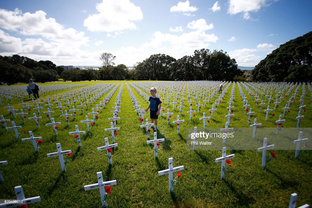 Familys and children walk through a field of memorial crosses on the lawn in front of the Auckland War Memorial Museum on April 20, 2017 in Auckland, New Zealand. The field of white crosses has been installed in the lead up to ANZAC Day. New Zealand. ANZAC Day commemorates the day Australian and New Zealand Army Corp (ANZAC) landed on the shores of Gallipoli on April 25, 1915, during World War 1. Anzac day is a national holiday in New Zealand and Australia, marked by a dawn service held during the time of the original Gallipoli landing and commemorated with ceremonies and parades throughout the day.