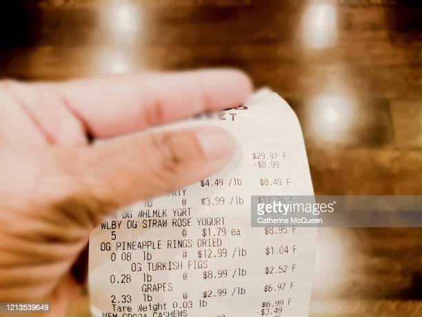 family's grocery receipt - crisis stock pictures, royalty-free photos & images