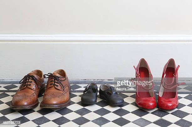 Family's shoes lined up in hallway
