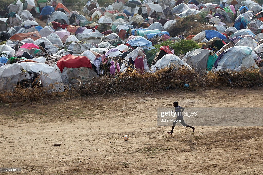 A famine refugee plays next to a camp for Somalis displaced by drought and famine on August 18, 2011 in Mogadishu, Somalia. The UN estimates that more than 100,000 people have fled their villages to Mogadishu in the last two months due to the crisis. Some 1.5 million Somalis are estimated displaced nationwide due to drought, famine and war. The UN is investigating reports that thousands of sacks of food aid for famine victims have been stolen and are for sale on the open market.