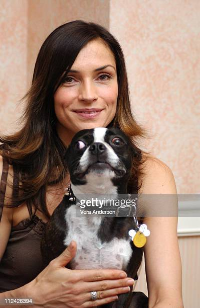 Famke Janssen and her bull terrier Licorice during 'Hide and Seek' Press Conference with Elisabeth Shue Famke Janssen and Dakota Fanning at Four...
