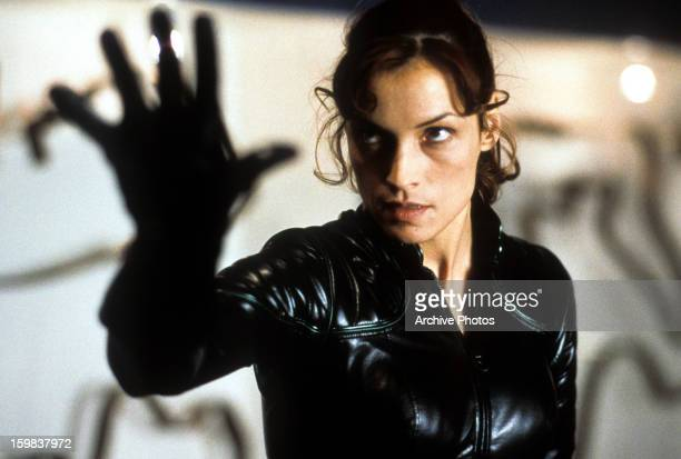 Famke Janssen holds up her hand in a scene from the film 'X-Men', 2000.