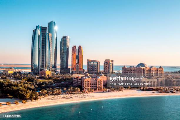 famous abu dhabi skyscrapers captured from a helicopter above a downtown area - abu dhabi stock pictures, royalty-free photos & images