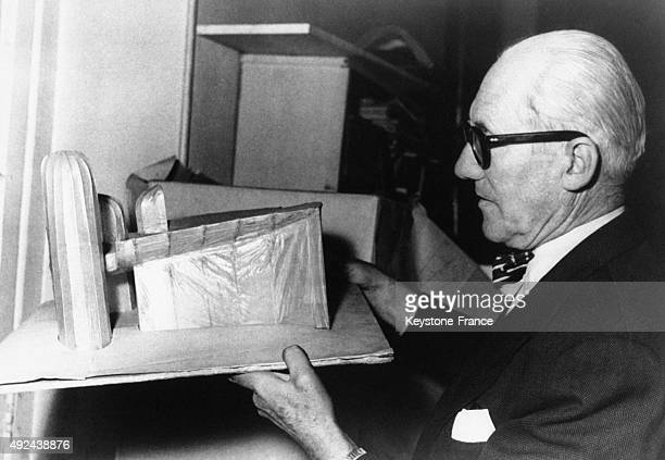Famous architect Le Corbusier holding a scale model of one of his secret project circa 1950 in Paris France