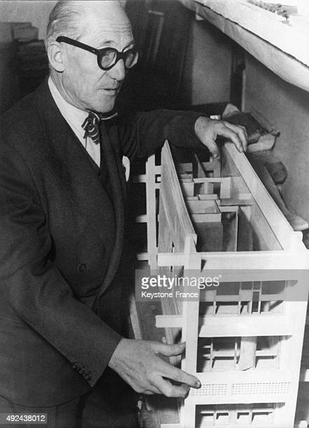 Famous architect Le Corbusier holding a scale model of 'The Cite Radieuse' of Reze circa 1950 in France