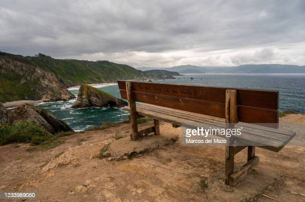Famous bench overlooking the Atlantic on the Loiba cliffs, located in San Julian de Loiba, in the municipality of Ortigueira, in Galicia. The bench...