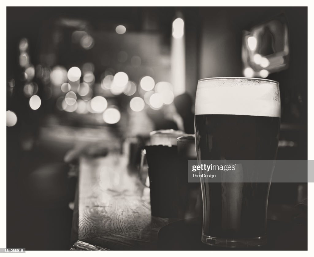 Famous Black Irish Stout In Pub Stock Photo