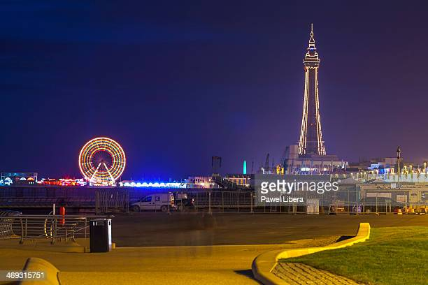 Famous Blackpool Tower Street Lights and Big Wheel on Central Pier illuminated at night