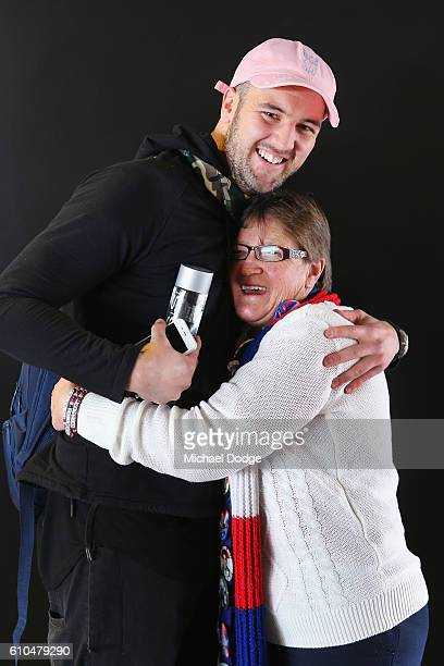 Famous Bulldogs supporter Irene Chatfield credited for helping save the club from folding is hugged by Matt Suckling of the Bulldogs during a Western...