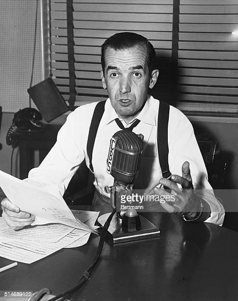 Famous CBS newscaster Edward R Murrow speaks before a microphone