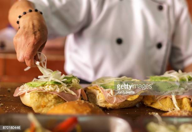 "famous ""cemita poblano"" being prepared by cook - puebla mexico stock pictures, royalty-free photos & images"
