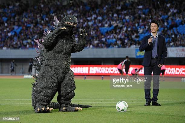 Famous character Godzilla and actorHiroki Hasegawa look on prior to the JLeague match between Kawasaki Frontale and FC Tokyo at the Todoroki Stadium...