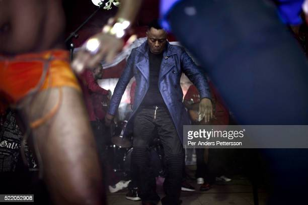 Famous Congolese artist King Kester Emeneya performs during a concert in a nightclub on February 15 2012 in Kinshasa DRC He resides in Paris and he...