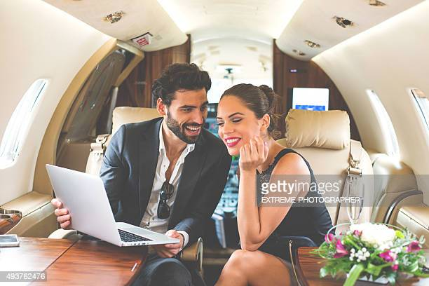 Famous couple in private jet airplane
