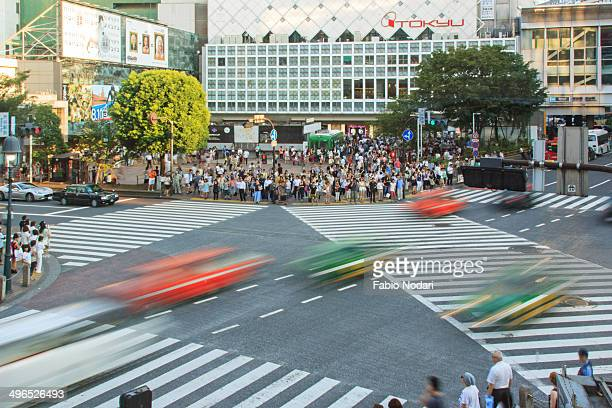 Famous crossroad in Shibuya, Tokyo, Japan aerial view at sunset, cars in motion.