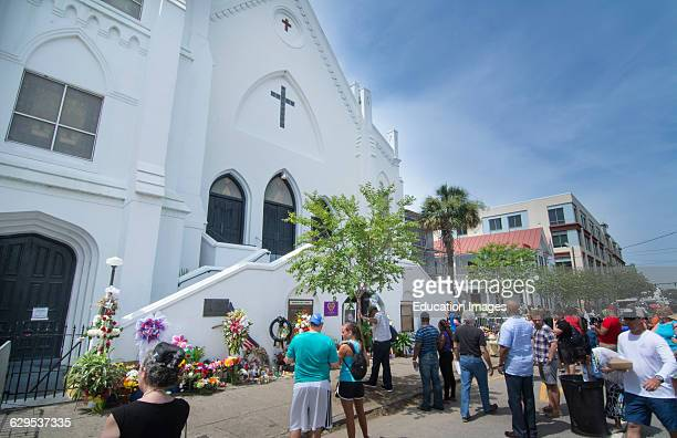 Famous Emanuel AME Church in Charleston South Carolina black church people leaving flowers and messages and taking pictures of the scene of horrible...