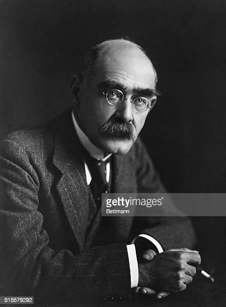 Famous English writer Rudyard Kipling smokes a cigarette.