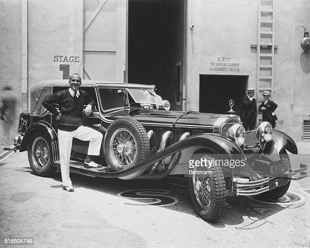 Famous entertainer Al Jolson stands alongside his MercedesBenz roadster outside a motionpicture studio on Sunset Boulevard