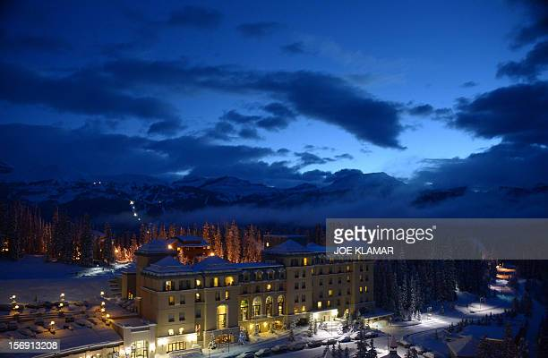 Famous Fairmont Chateau Hotel wakes up into the morning twilight at Lake Louise Alberta on November 24 2012 Lake Louise the famous Canadian winter...