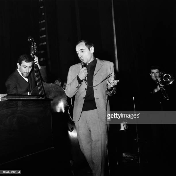 Famous French singer Charles Aznavour performs during his concert at the Olympia hall in Paris 17 January 1963