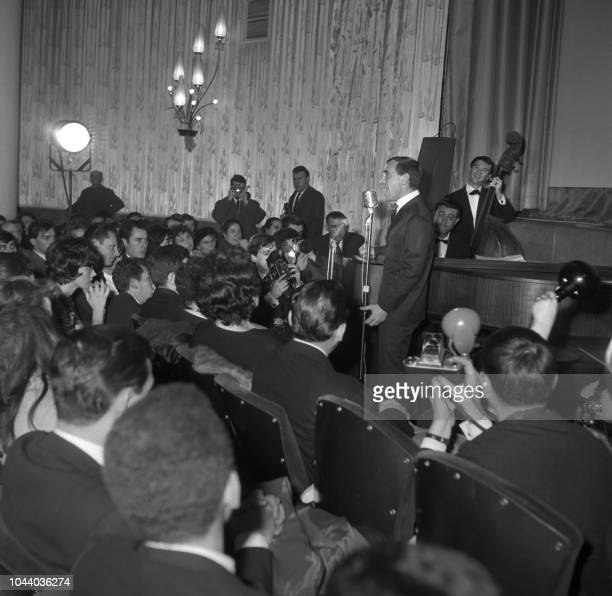 Famous French singer Charles Aznavour performs during the presentation of his film Horace 62 directed by Andre Versini at a cinema on the Champs...
