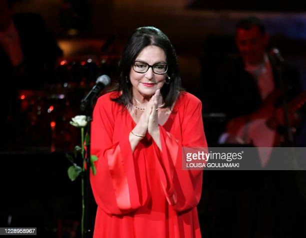 Famous Greek singer Nana Mouskouri performs in a tribute concert at the ancient Herodus Atticus theatre at the foot of the Acropolis on July 23,...
