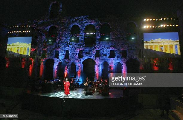 Famous Greek singer Nana Mouskouri performs in a tribute concert on July 23 2008 at the ancient Herodus Atticus theatre at the foot of the Acropolis...