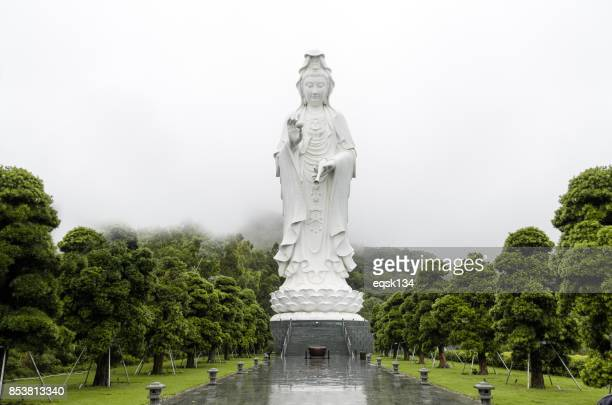 famous guanyin statue in hong kong - the faith of asian - guanyin bodhisattva stock pictures, royalty-free photos & images
