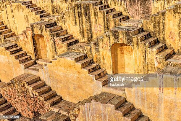 famous indian stepwell near jaipur, rajasthan - step well stock photos and pictures