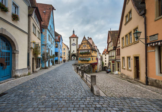famous intersection with stunning medieval buildings in rothenburg germany - germany stock pictures, royalty-free photos & images