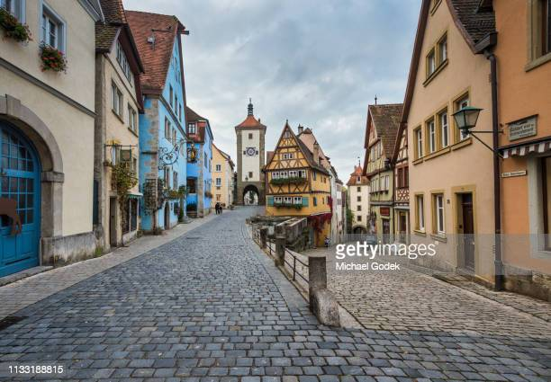 famous intersection with stunning medieval buildings in rothenburg germany - duitsland stockfoto's en -beelden