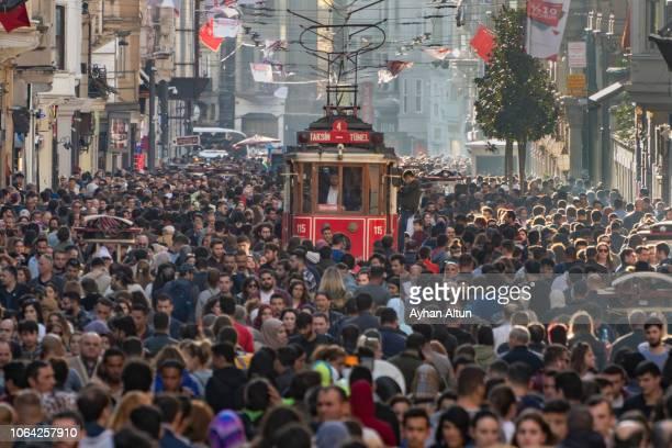 famous istiklal street in beyoglu district of istanbul,turkey - istanbul stock-fotos und bilder