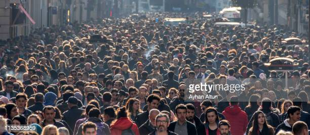 famous istiklal street in beyoglu district of istanbul,turkey - large group of people imagens e fotografias de stock