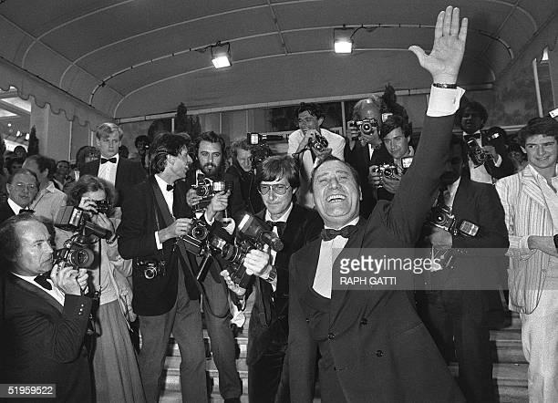 Famous Italian actor Alberto Sordi waves to the public during Cannes Film Festival 24 May 1981. Alberto Sordi, who began his film career dubbing...