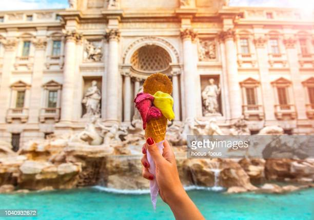 famous italian gelato at trevi fountain rome - roma stock photos and pictures