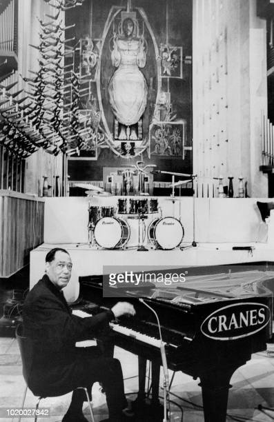Famous jazz musician conductor composer and piano player Duke Ellington plays the piano during the first European performance of his religious suite...