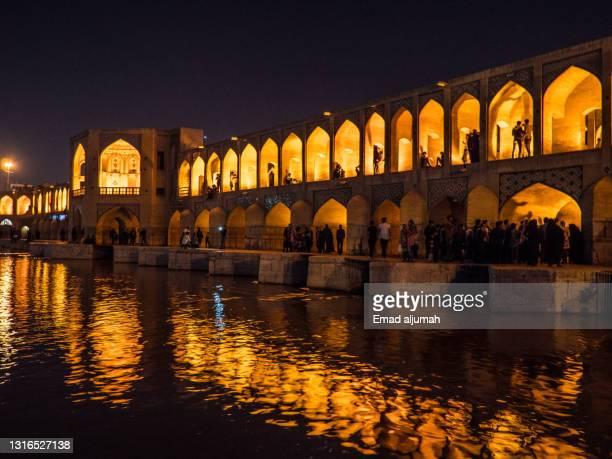 famous khaju bridge in isfahan, iran - ザーヤンド川 ストックフォトと画像