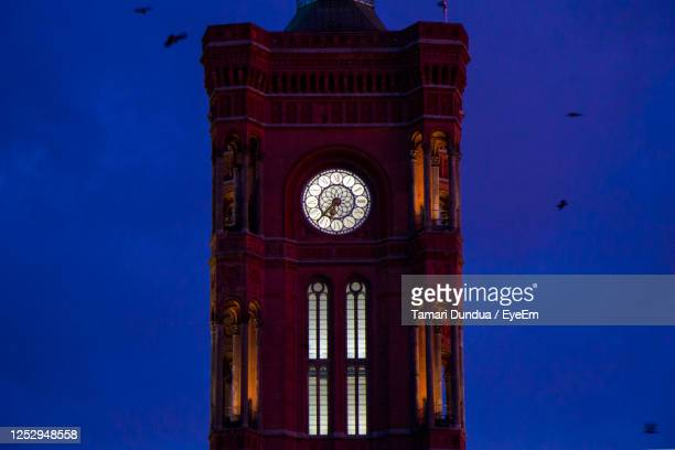 famous landmark and architecture clock tower, red tower in berlin - clock tower stock pictures, royalty-free photos & images