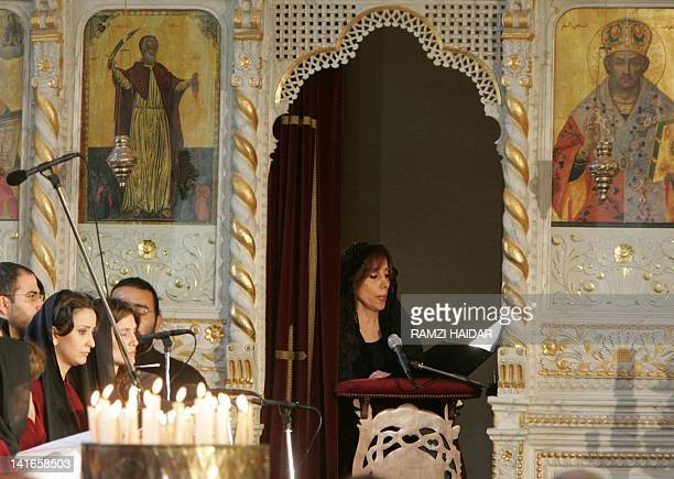 Famous Lebanese diva Fairuz sings lithurgical hymns 29 April 2005 at Good Friday mass at Saint Elias church in Mhaidseh village east of Beirut...