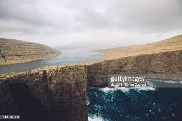 famous leitisvatn cliff with optical illusion - optical illusion stock photos and pictures