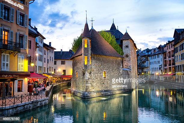 famous palais de l'isle, spring evening, annecy, france - lake annecy stock photos and pictures
