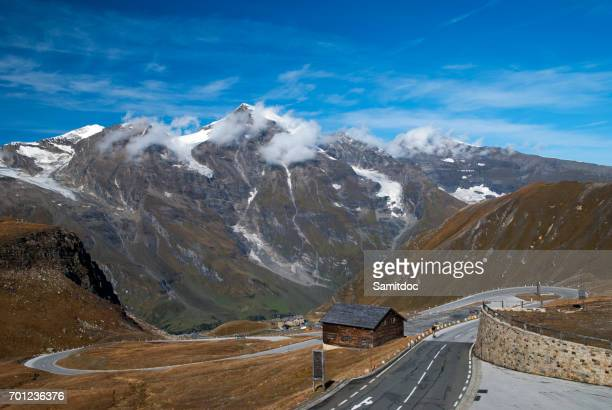 Famous picturesque views of the road in Austrian Alps - Grossglocknershtrasse. The highest mountain peaks covered with fresh snow