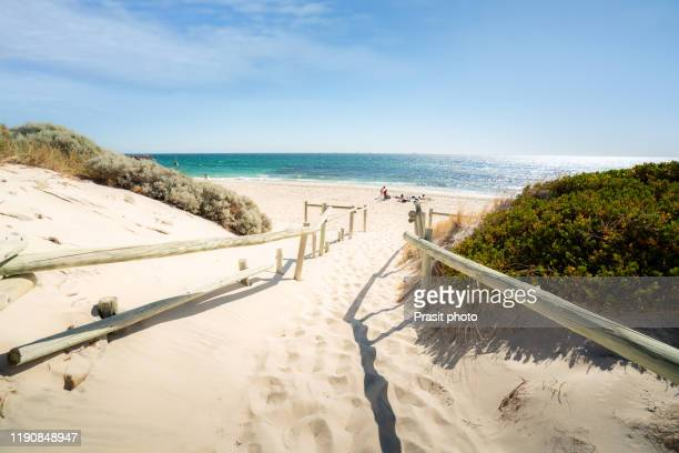 famous place cottesloe beach with tourist lying to sunbath and swimming on a summer afternoon in perth, western australia, australia. - perth australia stock pictures, royalty-free photos & images