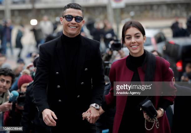Famous Portuguese football player Cristiano Ronaldo arrives at provincial court with his girlfriend Georgina Rodriguez for his tax evasion trial in...