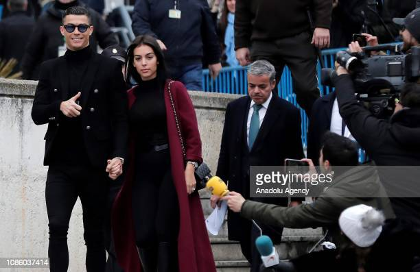 Famous Portuguese football player Cristiano Ronaldo leaves the provincial court with his girlfriend Georgina Rodriguez after his tax evasion trial in...