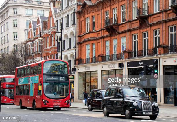 famous regent street with london red busses uk - central london stock pictures, royalty-free photos & images